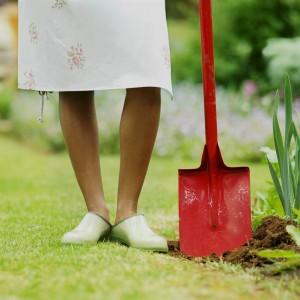 Woman holding spade